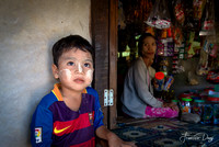 The child and the seller at the village shop kid Myanmar Burma boy