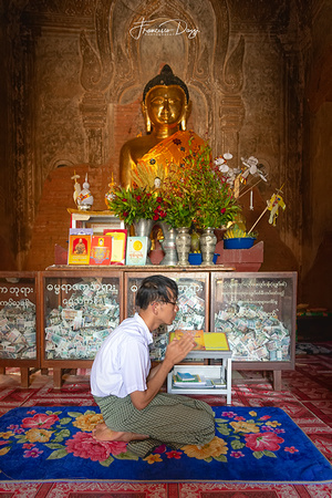 In prayer at Dhammayazika Pagoda in Bagan Myanmar man