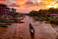Sunset over Nyaungshwe river channel Myanmar Asia scenic