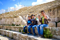 Smiling boys in the Roman Theater of Jerash Jordan