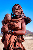 Himba mother with child Namibia people