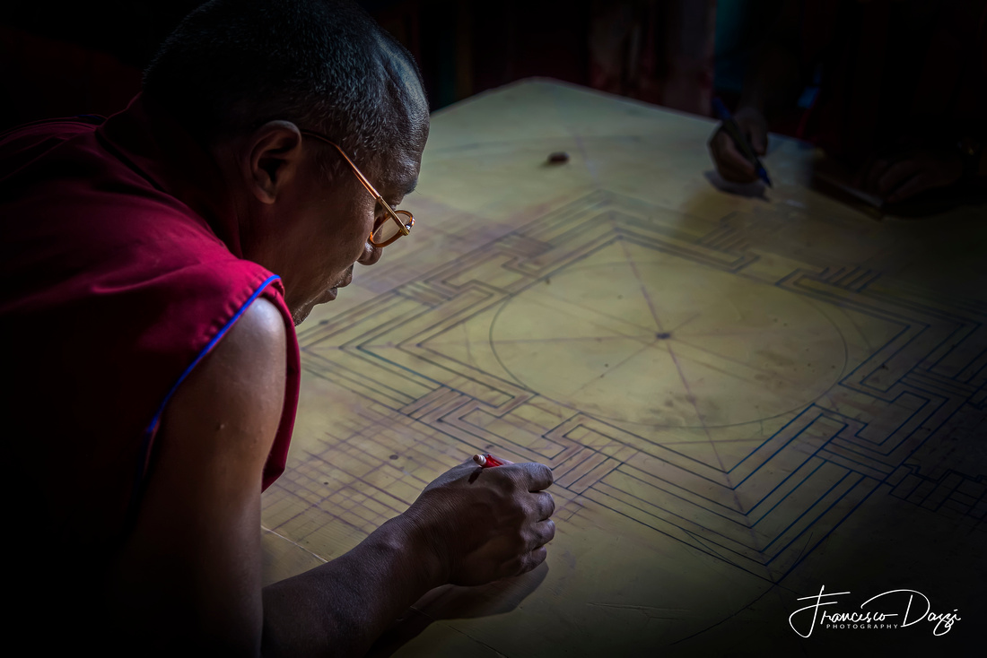 Monk working on mandala in Diskit Gompa Ladakh