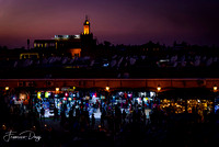 Jamaa el Fna at sunset in Marrakech square souq Morocco