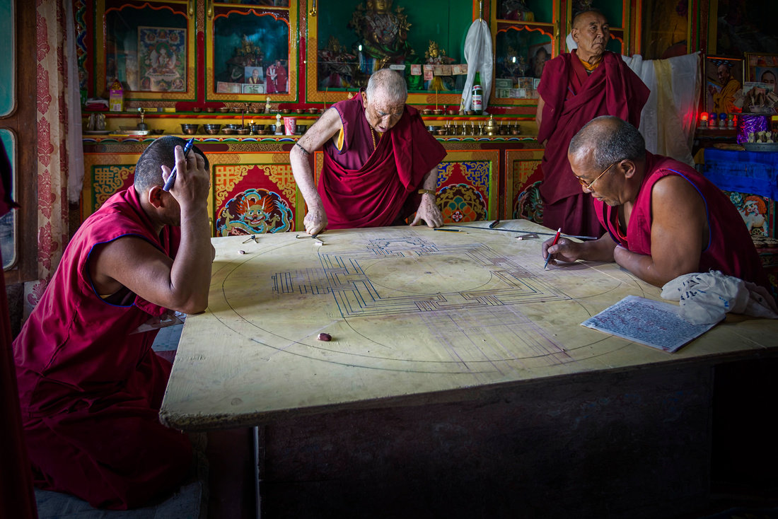 Monks working on mandala in Diskit monastery Ladakh India