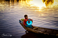 The young water bearer of Tonle Sap lake Cambodia