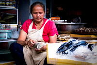 Doing business at Phnom Penh central market Cambodia Asia women